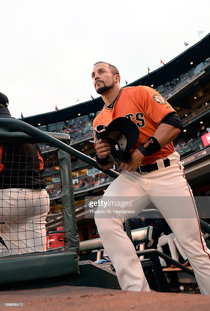 Andres Torres of the San Francisco Giants runs out of the dugout onto the field against the Atlanta Braves at ATT Park on May 10 2013 in San...