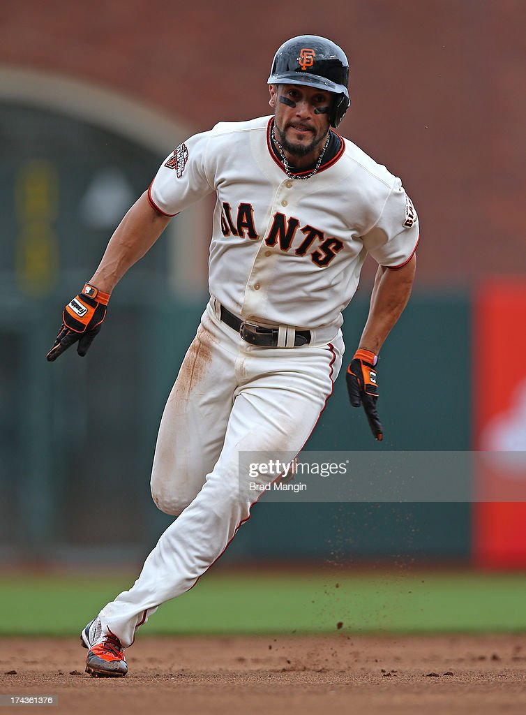 Andres Torres of the San Francisco Giants runs the bases during the game against the Cincinnati Reds at ATT Park on Tuesday July 23 2013 in San...