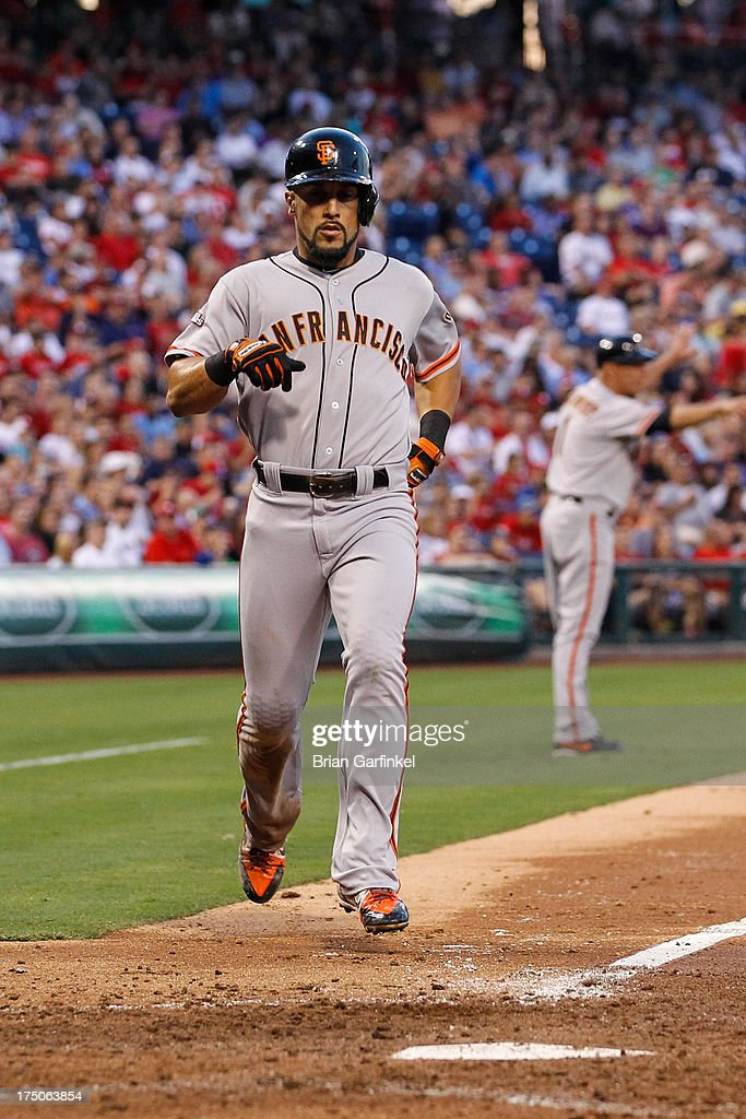 <a gi-track='captionPersonalityLinkClicked' href=/galleries/search?phrase=Andres+Torres&family=editorial&specificpeople=835839 ng-click='$event.stopPropagation()'>Andres Torres</a> #56 of the San Francisco Giants scores a run in the third inning of the game against the Philadelphia Phillies at Citizens Bank Park on July 30, 2013 in Philadelphia, Pennsylvania.