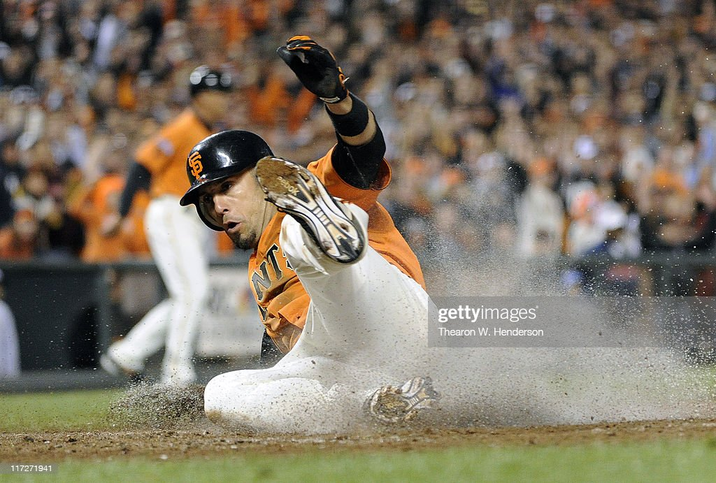 Andres Torres of the San Francisco Giants scores on a foul popout by Aubrey Huff against the Cleveland Indians in the bottom of the six inning during...
