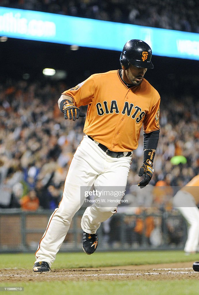 <a gi-track='captionPersonalityLinkClicked' href=/galleries/search?phrase=Andres+Torres&family=editorial&specificpeople=835839 ng-click='$event.stopPropagation()'>Andres Torres</a> #56 of the San Francisco Giants scores the winning run in the ninth inning against the Cincinnati Reds during a MLB baseball game June 10, 2011 at AT&T Park in San Francisco, California. The Giants won the game 3-2.