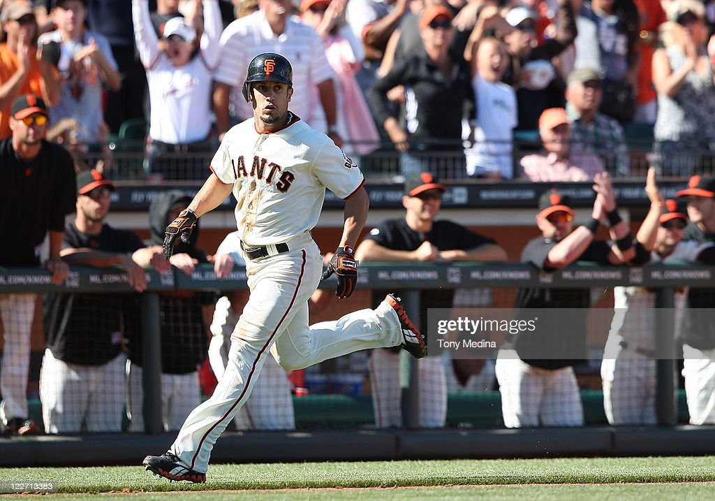 <a gi-track='captionPersonalityLinkClicked' href=/galleries/search?phrase=Andres+Torres&family=editorial&specificpeople=835839 ng-click='$event.stopPropagation()'>Andres Torres</a> #56 of the San Francisco Giants scores to tie the score at 3-3 in the bottom of the tenth inning on a single by Mark DeRosa #7 of the San Francisco Giants (not pictured) during a game between the Houston Astros and the San Francisco Giants at AT&T Park on August 28, 2011 in San Francisco, California.