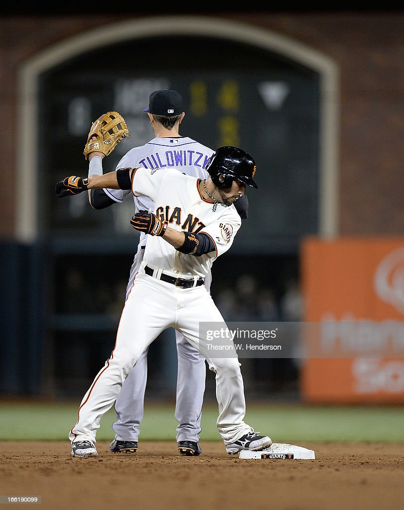 <a gi-track='captionPersonalityLinkClicked' href=/galleries/search?phrase=Andres+Torres&family=editorial&specificpeople=835839 ng-click='$event.stopPropagation()'>Andres Torres</a> #56 of the San Francisco Giants stands on second after hitting a double as <a gi-track='captionPersonalityLinkClicked' href=/galleries/search?phrase=Troy+Tulowitzki&family=editorial&specificpeople=757353 ng-click='$event.stopPropagation()'>Troy Tulowitzki</a> #2 of the Colorado Rockies waits on the through in the bottom of the eighth inning at AT&T Park on April 9, 2013 in San Francisco, California. The Giants won the game 9-6.