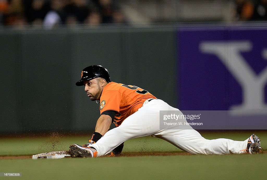 <a gi-track='captionPersonalityLinkClicked' href=/galleries/search?phrase=Andres+Torres&family=editorial&specificpeople=835839 ng-click='$event.stopPropagation()'>Andres Torres</a> #56 of the San Francisco Giants steals second base against the San Diego Padres in the ninth inning at AT&T Park on April 19, 2013 in San Francisco, California. The Giants won the game when Torres scored on an RBI walk off single from Angel Pagan #16.