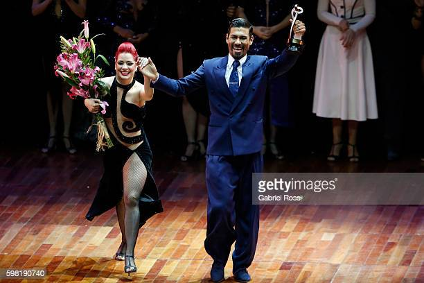 Andres Uran and Estefania Arango of Colombia celebrate after winning the third place on the Stage Tango Final as part of Buenos Aires Tango Festival...