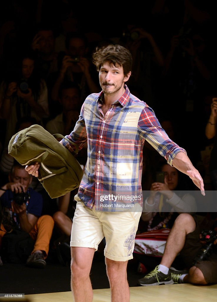 <a gi-track='captionPersonalityLinkClicked' href=/galleries/search?phrase=Andres+Velencoso&family=editorial&specificpeople=2089819 ng-click='$event.stopPropagation()'>Andres Velencoso</a> walks the runway for the Desigual collection 'Say Something Nice To Men' at the 080 Barcelona Fashion Week 2014 on July 1, 2014 in Barcelona, Spain.