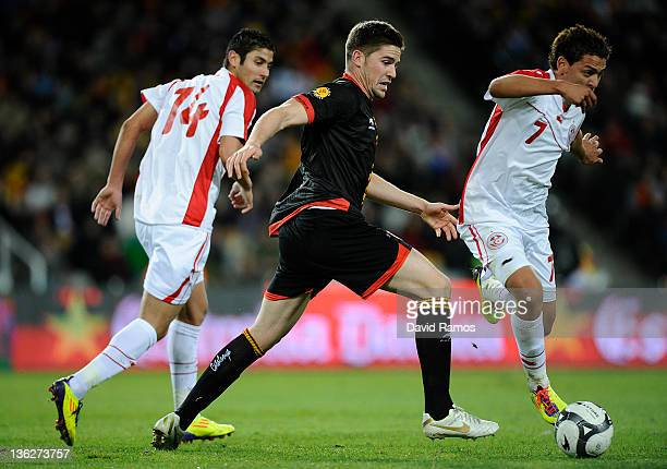 Andreu Fontas of Catalonia duels for the ball with Youssef Misakui and Mejoli Traoni during an International Friendly match between Catalonia and...