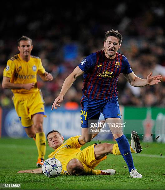 Andreu Fontas of FC Barcelona evades a challenge from Aleksandr Yurevich of FC BATE Borisov during the UEFA Champions League group H match between FC...