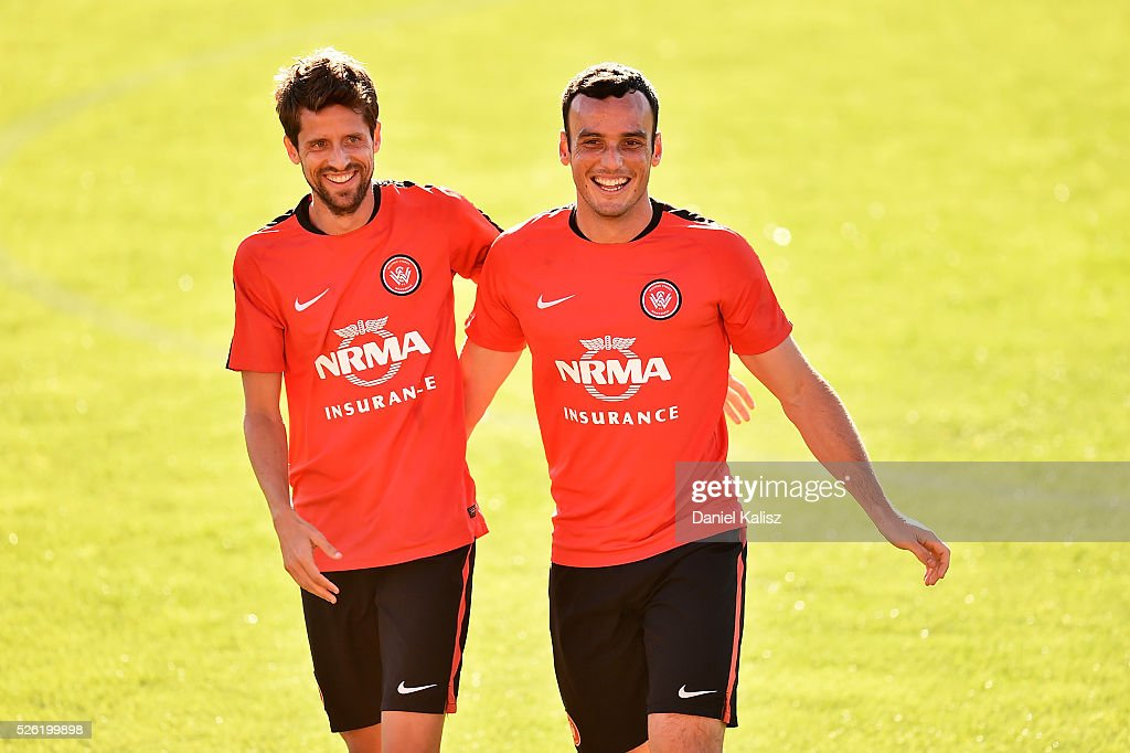 Andreu Guerao Mayoral and Mark Bridge of the Wanderers share a laugh during a Western Sydney Wanderers A-League training session at Coopers Stadium on April 30, 2016 in Adelaide, Australia.