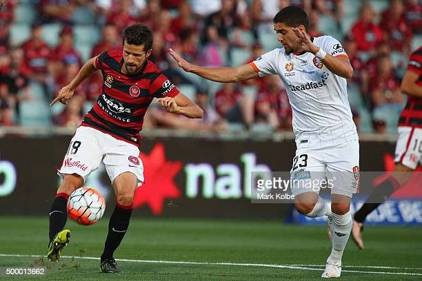 Andreu of the Wanderers clear the ball under pressure from Dimitri Petratos of the Roar during the round nine ALeague match between the Western...