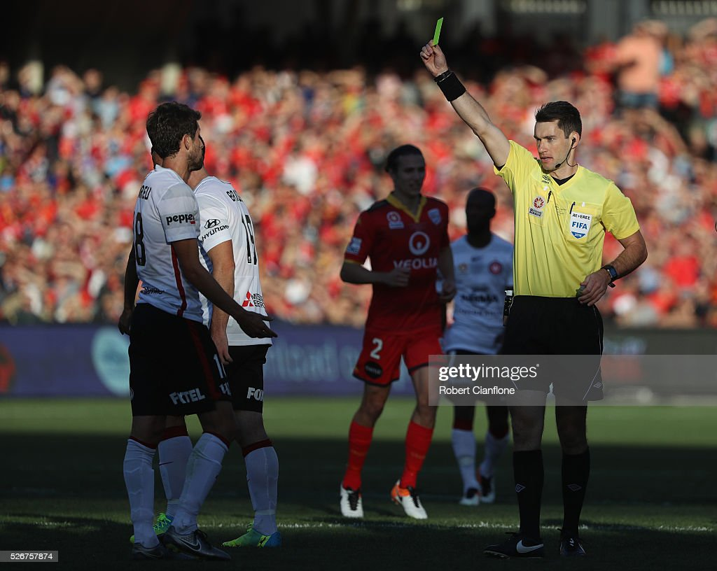 Andreu of the Wanderers is shown the yellow card by referee Jarred Gillett of the Wanderers during the 2015/16 A-League Grand Final match between Adelaide United and the Western Sydney Wanderers at Adelaide Oval on May 1, 2016 in Adelaide, Australia.