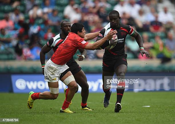Andrew Amonde of Kenya is tackled by Axel Muller of Argentina during the Bowl Final match between Kenya and Argentina in the Marriott London Sevens...