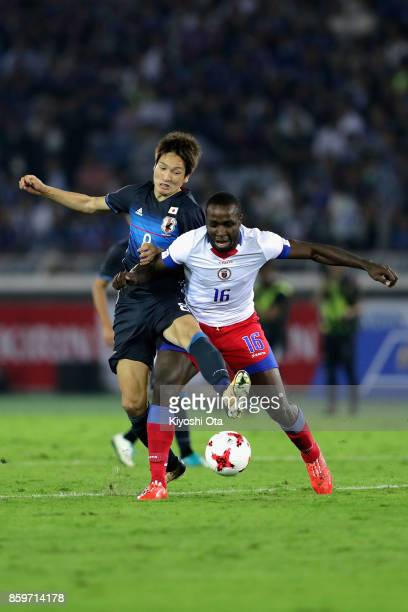 Andrew Anderson JeanBaptiste of Haiti and Genki Haraguchi of Japan compete for the ball during the international friendly match between Japan and...