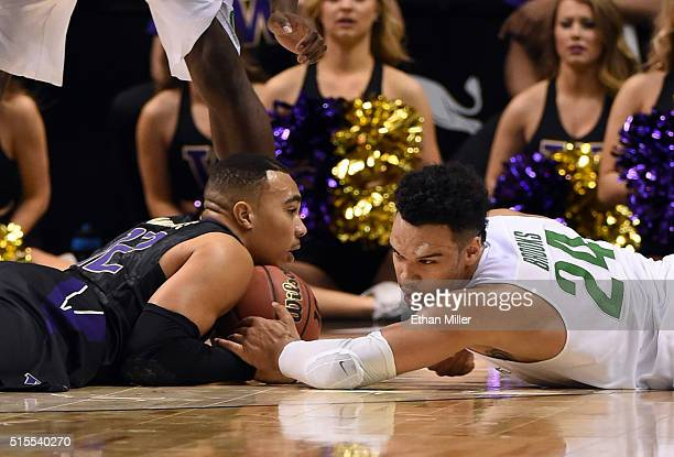 Andrew Andrews of the Washington Huskies and Dillon Brooks of the Oregon Ducks go after a loose ball during a quarterfinal game of the Pac12...