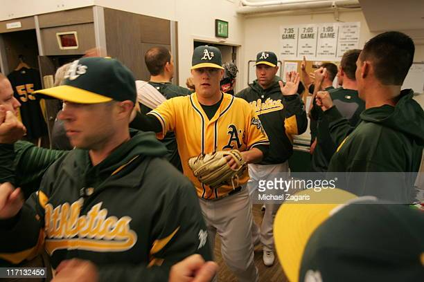 Andrew Bailey and Michael Wuertz of the Oakland Athletics are congratulated in the clubhouse after the game against the San Francisco Giants at the...