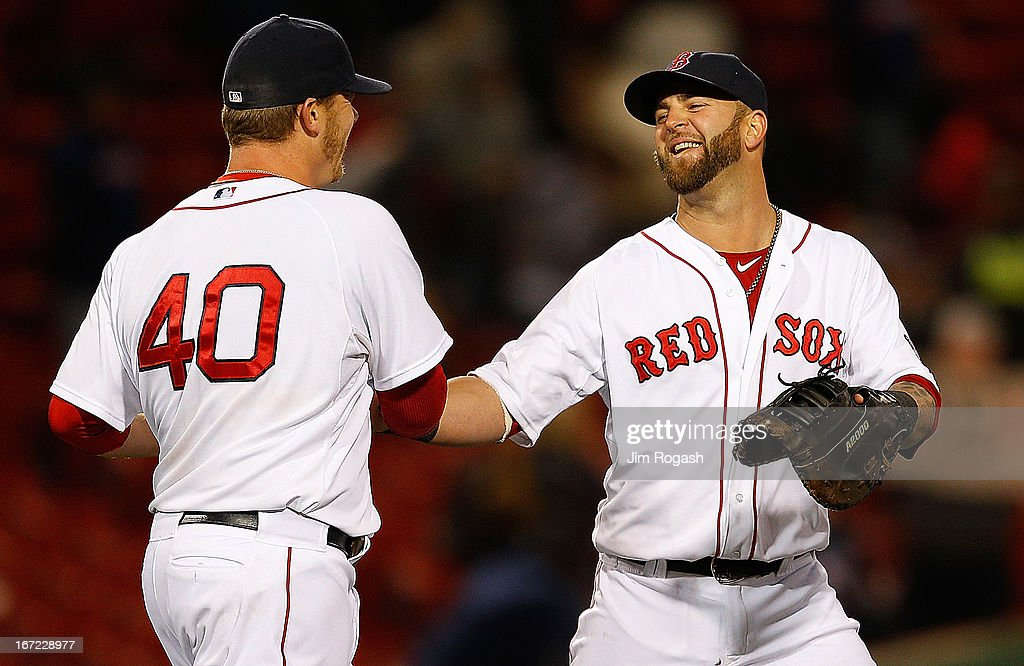 Andrew Bailey #40 of the Boston Red Sox and <a gi-track='captionPersonalityLinkClicked' href=/galleries/search?phrase=Mike+Napoli&family=editorial&specificpeople=525007 ng-click='$event.stopPropagation()'>Mike Napoli</a> #12 of the Boston Red Sox react after defeating the Oakland Athletics, 9-6, at Fenway Park on April 22, 2013 in Boston, Massachusetts.