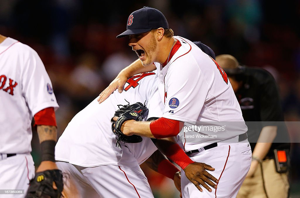 Andrew Bailey #40 of the Boston Red Sox celebrates with teammate <a gi-track='captionPersonalityLinkClicked' href=/galleries/search?phrase=David+Ortiz&family=editorial&specificpeople=175825 ng-click='$event.stopPropagation()'>David Ortiz</a> #34 of the Boston Red Sox after striking out the side to end the game and win 6-5 against the Oakland Athletics in the ninth inning during the game on April 24, 2013 at Fenway Park in Boston, Massachusetts.