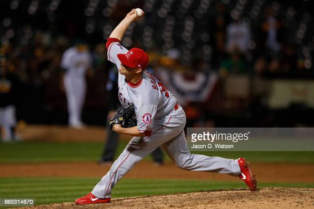 Andrew Bailey of the Los Angeles Angels of Anaheim pitches against the Oakland Athletics during the eighth inning at the Oakland Coliseum on April 4...