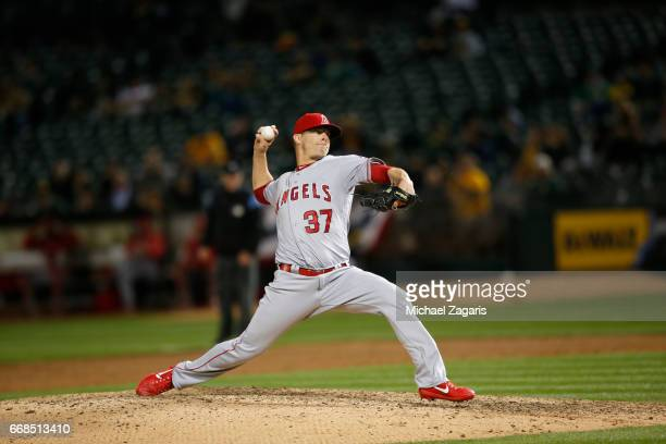 Andrew Bailey of the Los Angeles Angels of Anaheim pitches during the game against the Oakland Athletics at the Oakland Alameda Coliseum on April 4...