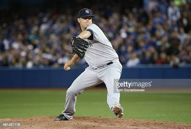 Andrew Bailey of the New York Yankees delivers a pitch in the seventh inning during MLB game action against the Toronto Blue Jays on September 21...