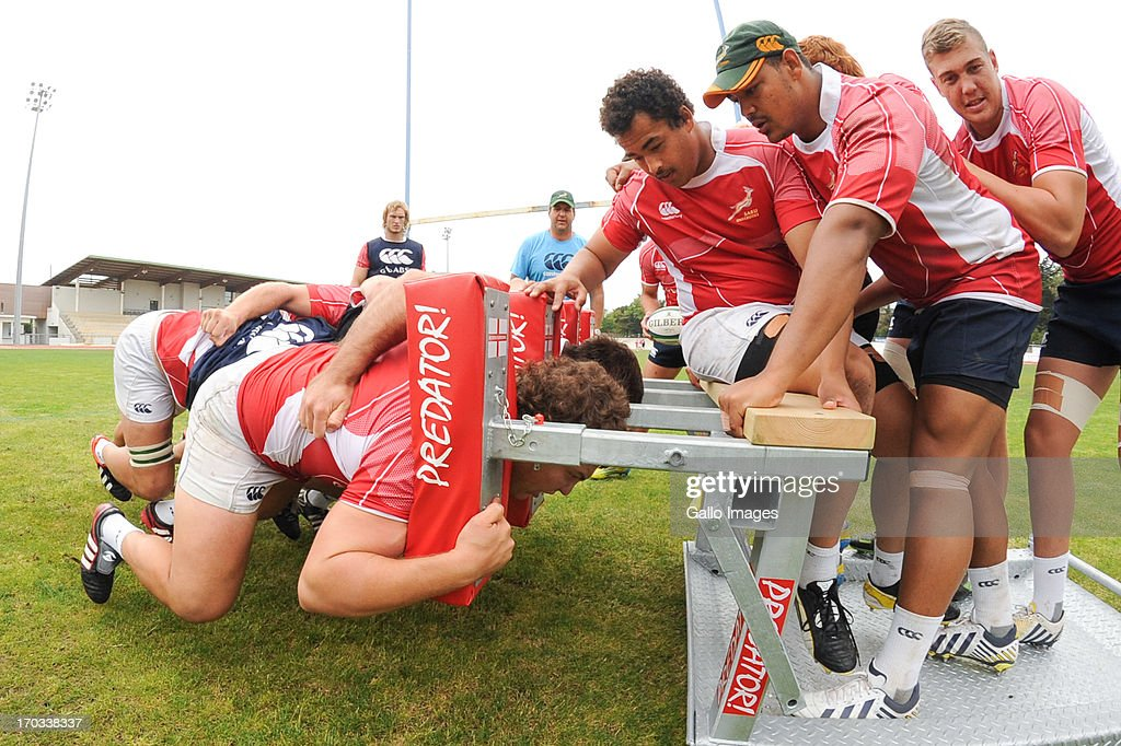 D' OLONNE, FRANCE - JUNE 11: (SOUTH AFRICA OUT) Andrew Beerwinkel, Devon Marthinus and Aidon Davis watch as Marnus Coetzee pushes in the scrum during the South African U/20 training session at Stade les Sables d' Olonne on June 11, 2013 in les Sables d' Olonne, France.