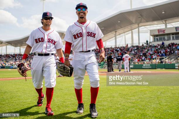 Andrew Benintendi and Mookie Betts of the Boston Red Sox react before a Spring Training game against the Atlanta Braves on March 5 2017 at Fenway...