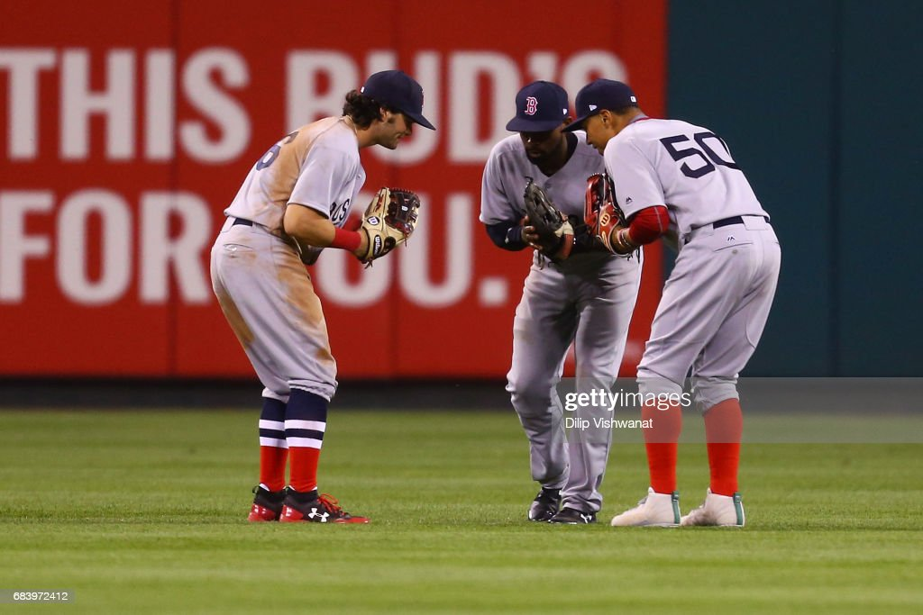 Andrew Benintendi #16, Jackie Bradley Jr. #19 and Mookie Betts #50 of the Boston Red Sox celebrate after beating the St. Louis Cardinals at Busch Stadium on May 16, 2017 in St. Louis, Missouri.