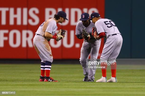 Andrew Benintendi Jackie Bradley Jr #19 and Mookie Betts of the Boston Red Sox celebrate after beating the St Louis Cardinals at Busch Stadium on May...