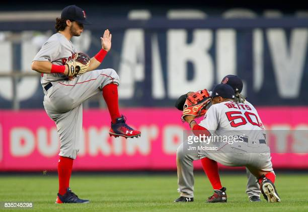 Andrew Benintendi Jackie Bradley Jr #19 and Mookie Betts of the Boston Red Sox celebrate after defeating the New York Yankees at Yankee Stadium on...
