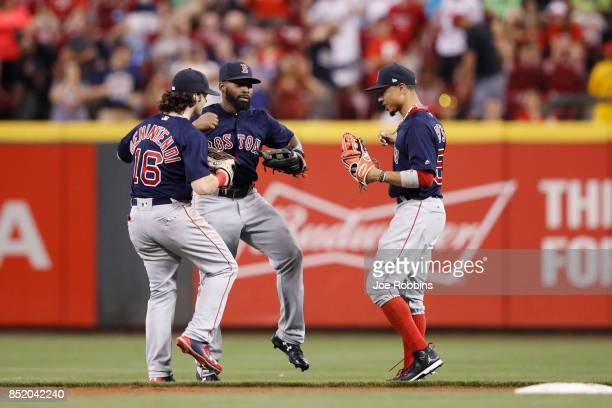 Andrew Benintendi Jackie Bradley Jr #19 and Mookie Betts of the Boston Red Sox celebrate after the final out in the ninth inning of a game against...