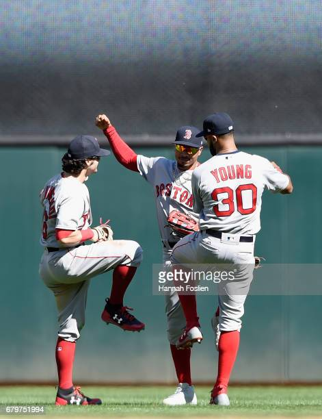 Andrew Benintendi Mookie Betts and Chris Young of the Boston Red Sox celebrate winning the game against the Minnesota Twins on May 6 2017 at Target...