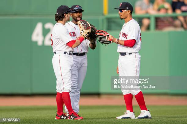 Andrew Benintendi Mookie Betts and Jackie Bradley Jr #19 of the Boston Red Sox meet in center field during the seventh inning of a game against the...