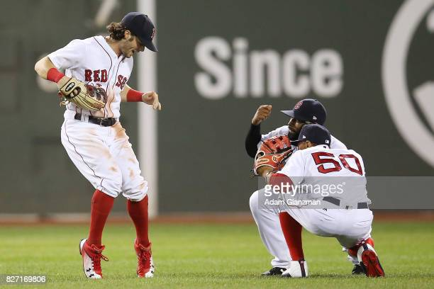 Andrew Benintendi Mookie Betts and Jackie Bradley Jr #19 of the Boston Red Sox react after a victory over the Chicago White Sox at Fenway Park on...