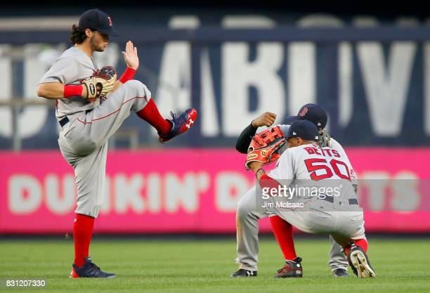 Andrew Benintendi Mookie Betts and Jackie Bradley Jr #19 of the Boston Red Sox celebrate after defeating the New York Yankees at Yankee Stadium on...