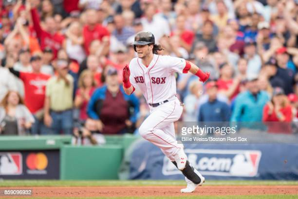 Andrew Benintendi of the Boston Red Sox advances to second base on an overthrown ball during the fourth inning of game three of the American League...