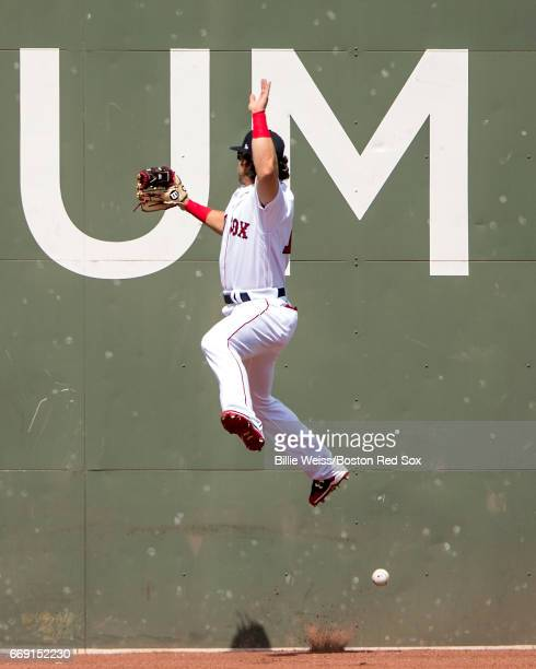 Andrew Benintendi of the Boston Red Sox attempts to catch a fly ball but cannot make the catch during the first inning of a game against the Tampa...