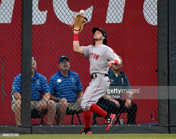 Andrew Benintendi of the Boston Red Sox catches a ball hit by Lorenzo Cain of the Kansas City Royals in the third inning at Kauffman Stadium on June...