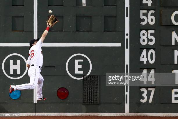 Andrew Benintendi of the Boston Red Sox catches a fly ball hit by Josh Donaldson of the Toronto Blue Jays during the first inning at Fenway Park on...