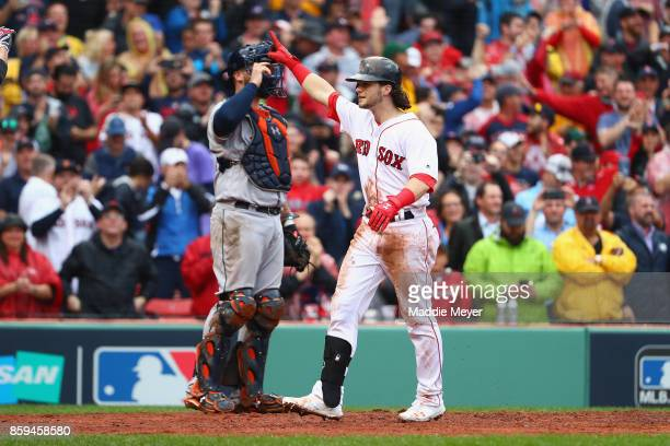 Andrew Benintendi of the Boston Red Sox celebrates after hitting a tworun home run in the fifth inning against the Houston Astros during game four of...