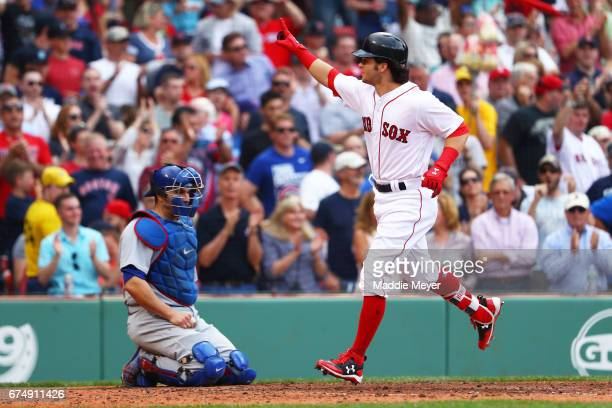 Andrew Benintendi of the Boston Red Sox celebrates in front of Miguel Montero of the Chicago Cubs after hitting a home run during the fifth inning at...