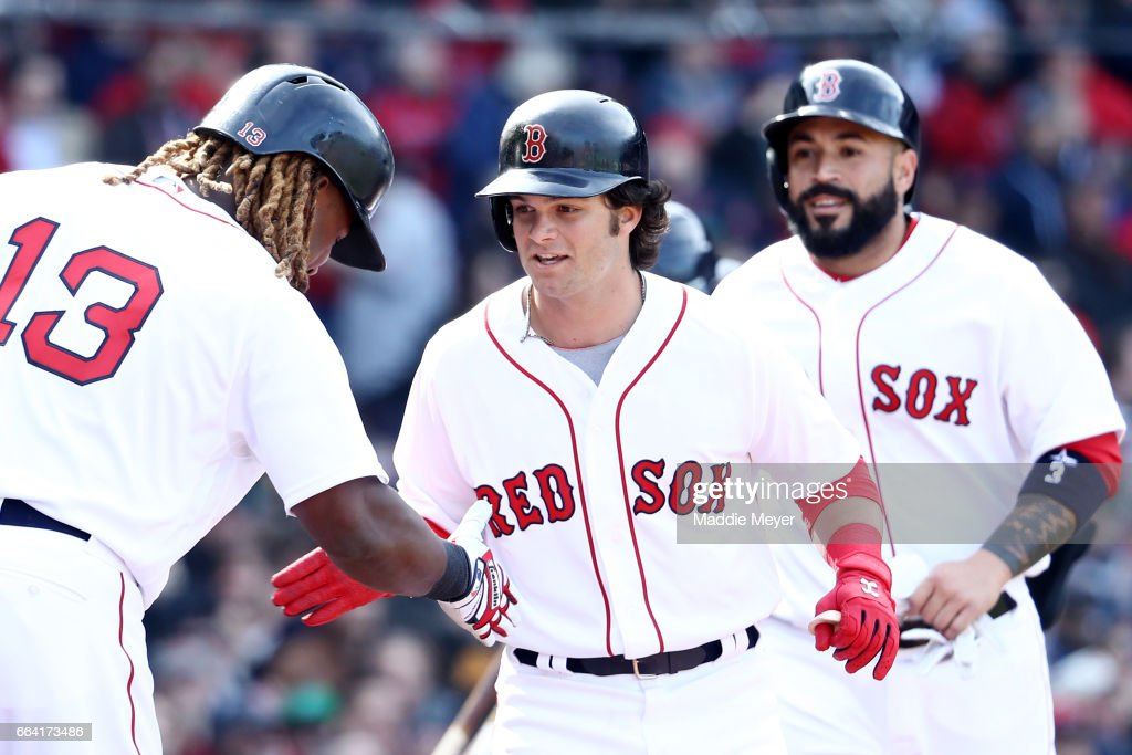 Andrew Benintendi #16 of the Boston Red Sox celebrates with Hanley Ramirez #13 after hitting a three run home run against the Pittsburgh Pirates during the fifth inning of the opening day game at Fenway Park on April 3, 2017 in Boston, Massachusetts.