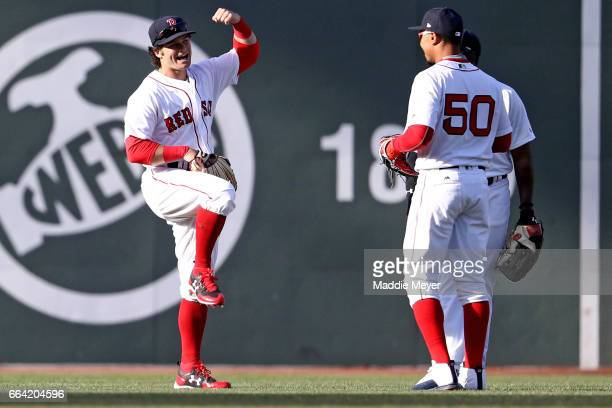 Andrew Benintendi of the Boston Red Sox celebrates with Jackie Bradley Jr #19 and Mookie Betts after defeating the Pittsburgh Pirates 53 in the...