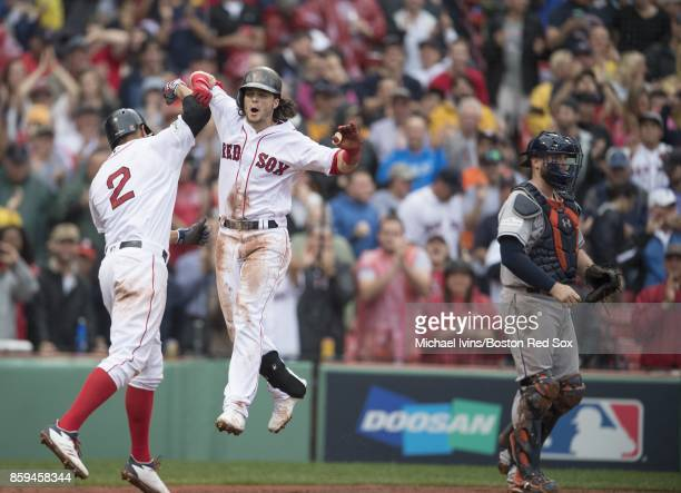 Andrew Benintendi of the Boston Red Sox celebrates with Xander Bogaerts after hitting a tworun home run against the Houston Astros in the fifth...