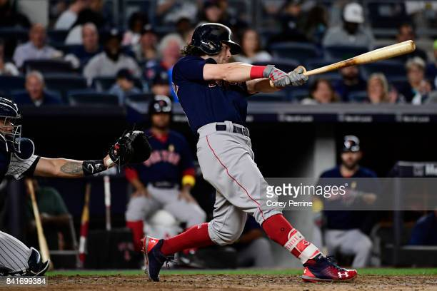 Andrew Benintendi of the Boston Red Sox connects on a solo home run during the fifth inning against the New York Yankees at Yankee Stadium on...
