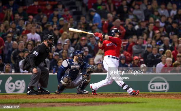 Andrew Benintendi of the Boston Red Sox flies out to center field during the seventh inning of a game against the Tampa Bay Rays at Fenway Park on...