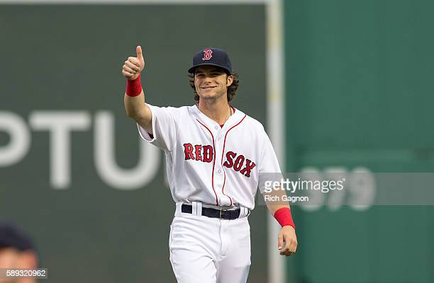 Andrew Benintendi of the Boston Red Sox gives a thumbsup to the crowd before a game against the Arizona Diamondbacks at Fenway Park on August 13 2016...