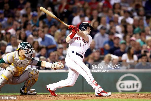 Andrew Benintendi of the Boston Red Sox hits a double against the Oakland Athletics during the third inning at Fenway Park on September 13 2017 in...