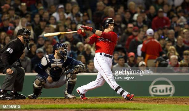 Andrew Benintendi of the Boston Red Sox hits a foul ball against the Tampa Bay Rays during the fourth inning at Fenway Park on May 12 2017 in Boston...