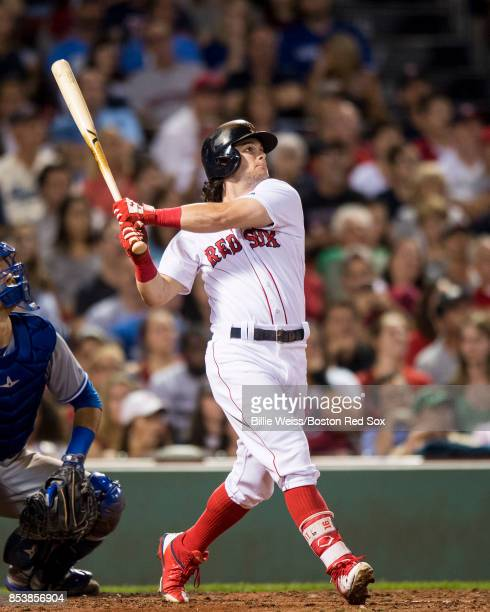 Andrew Benintendi of the Boston Red Sox hits a pinch hit solo home run during the ninth inning of a game against the Toronto Blue Jays on September...