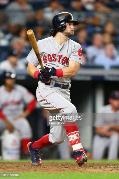 Andrew Benintendi of the Boston Red Sox hits a RBI single in the tenth inning against the New York Yankees at Yankee Stadium on August 13 2017 in the...